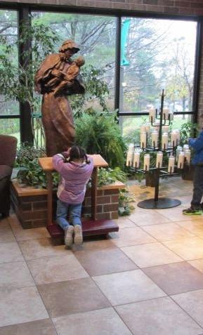 Praying by St. Elizabeth Ann Seton Statue
